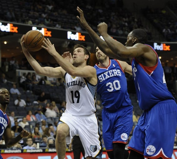 Apr 11, 2014; Memphis, TN, USA; Memphis Grizzlies guard Beno Udrih (19) lays the ball up against Philadelphia 76ers center Byron Mullens (30) during the game at FedExForum. Memphis Grizzlies beat Philadelphia 76ers 117 - 95. Mandatory Credit: Justin Ford-USA TODAY Sports