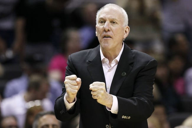 Apr 11, 2014; San Antonio, TX, USA; San Antonio Spurs head coach Gregg Popovich gives direction to his team during the first half against the Phoenix Suns at AT&T Center. Mandatory Credit: Soobum Im-USA TODAY Sports