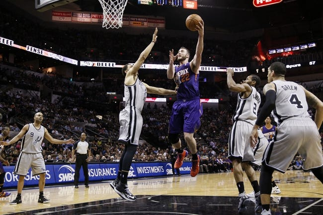 Apr 11, 2014; San Antonio, TX, USA; Phoenix Suns  center Miles Plumlee (22) shoots the ball over San Antonio Spurs forward Jeff Ayres (left) during the second half at AT&T Center. The Spurs won 112-104. Mandatory Credit: Soobum Im-USA TODAY Sports