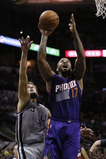 Apr 11, 2014; San Antonio, TX, USA; Phoenix Suns forward P.J Tucker (17) shoots the ball past San Antonio Spurs forward Marco Belinelli (3) during the second half at AT&T Center. The Spurs won 112-104. Mandatory Credit: Soobum Im-USA TODAY Sports