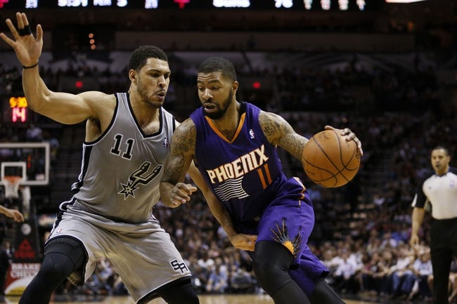 Apr 11, 2014; San Antonio, TX, USA; Phoenix Suns forward Markieff Morris (11) drives to the basket as San Antonio Spurs forward Jeff Ayres (11) defends during the second half at AT&T Center. The Spurs won 112-104. Mandatory Credit: Soobum Im-USA TODAY Sports