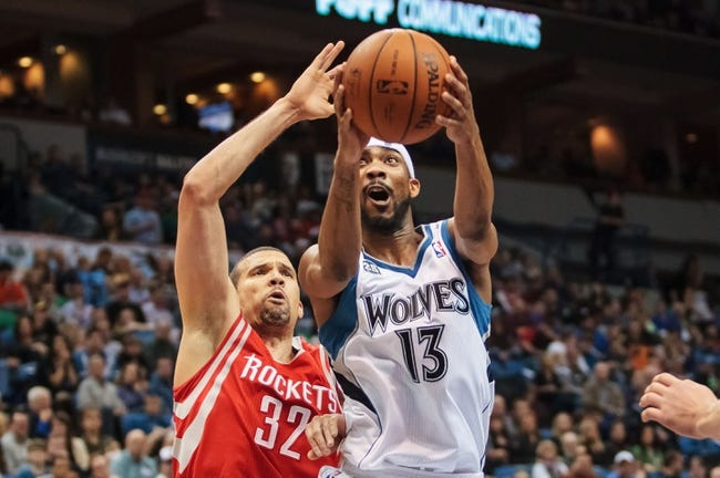 Apr 11, 2014; Minneapolis, MN, USA; Minnesota Timberwolves forward Corey Brewer (13) shoots in the fourth quarter against the Houston Rockets guard Francisco Garcia (32) at Target Center. The Minnesota Timberwolves win 112-110. Mandatory Credit: Brad Rempel-USA TODAY Sports