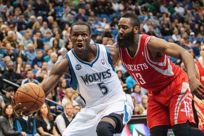Apr 11, 2014; Minneapolis, MN, USA; Minnesota Timberwolves center Gorgui Dieng (5) shoots in the fourth quarter against the Houston Rockets guard James Harden (13) at Target Center. The Minnesota Timberwolves win 112-110. Mandatory Credit: Brad Rempel-USA TODAY Sports