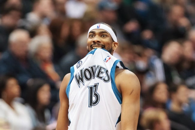 Apr 11, 2014; Minneapolis, MN, USA; Minnesota Timberwolves forward Corey Brewer (13) bites his jersey in the second quarter against the Houston Rockets at Target Center. The Minnesota Timberwolves win 112-110. Mandatory Credit: Brad Rempel-USA TODAY Sports