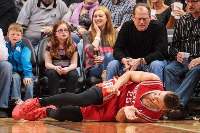 Apr 11, 2014; Minneapolis, MN, USA; Houston Rockets forward Chandler Parsons (25) lies on the floor in the third quarter against the Minnesota Timberwolves at Target Center. The Minnesota Timberwolves win 112-110. Mandatory Credit: Brad Rempel-USA TODAY Sports