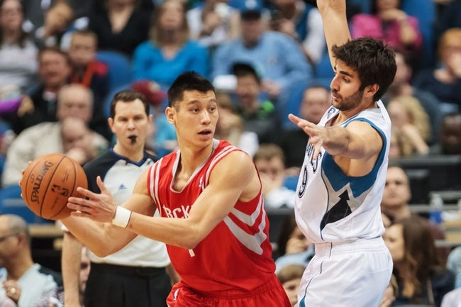 Apr 11, 2014; Minneapolis, MN, USA; Houston Rockets guard Jeremy Lin (7) passes in the fourth quarter against the Minnesota Timberwolves guard Ricky Rubio (9) at Target Center. The Minnesota Timberwolves win 112-110. Mandatory Credit: Brad Rempel-USA TODAY Sports
