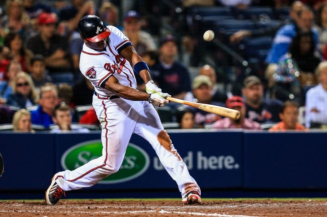 Apr 11, 2014; Atlanta, GA, USA; Atlanta Braves left fielder Justin Upton (8) hits a walk off single in the tenth inning against the Washington Nationals at Turner Field. The Braves won 7-6. Mandatory Credit: Daniel Shirey-USA TODAY Sports