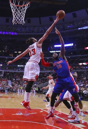 Apr 11, 2014; Chicago, IL, USA; Chicago Bulls center Joakim Noah (13) blocks the shot of Detroit Pistons forward Greg Monroe (10) during the first half at the United Center. Mandatory Credit: Dennis Wierzbicki-USA TODAY Sports