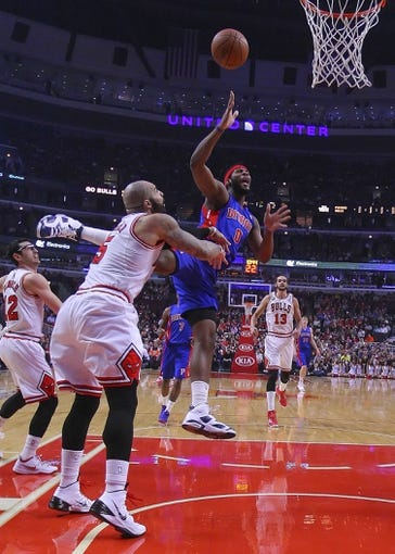 Apr 11, 2014; Chicago, IL, USA; Detroit Pistons center Andre Drummond (0) shoots over Chicago Bulls forward Carlos Boozer (5) during the first half at the United Center. Mandatory Credit: Dennis Wierzbicki-USA TODAY Sports