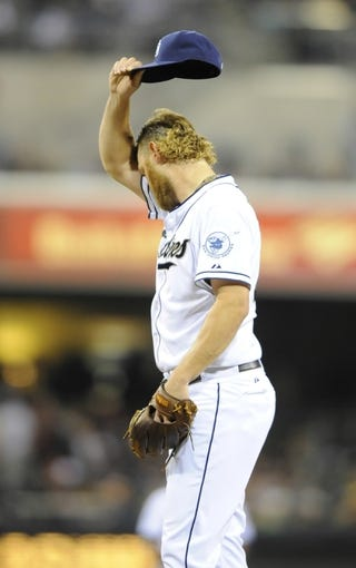 Apr 11, 2014; San Diego, CA, USA; San Diego Padres starting pitcher Andrew Cashner (34) reacts after giving up his first hit during the sixth inning against the Detroit Tigers at Petco Park. Mandatory Credit: Christopher Hanewinckel-USA TODAY Sports