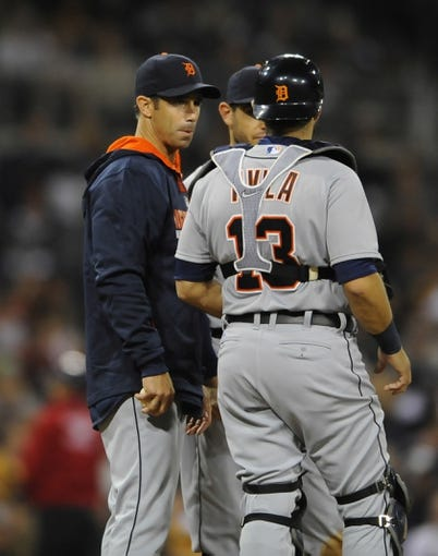 Apr 11, 2014; San Diego, CA, USA; Detroit Tigers manager Brad Ausmus (7) talks with catcher Alex Avila (13) during a pitching change in the seventh inning against the San Diego Padres at Petco Park. Mandatory Credit: Christopher Hanewinckel-USA TODAY Sports