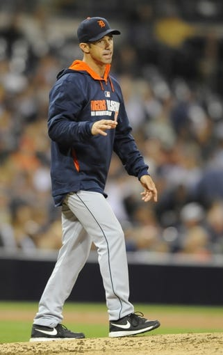 Apr 11, 2014; San Diego, CA, USA; Detroit Tigers manager Brad Ausmus (7) during a pitching change in the seventh inning against the San Diego Padres at Petco Park. Mandatory Credit: Christopher Hanewinckel-USA TODAY Sports
