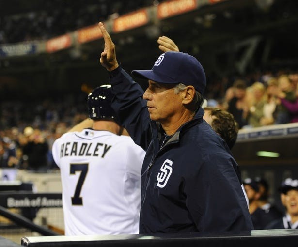 Apr 11, 2014; San Diego, CA, USA; San Diego Padres manager Bud Black (20) congratulates third baseman Chase Headley (7) after a two-run home run during the sixth inning against the Detroit Tigers at Petco Park. Mandatory Credit: Christopher Hanewinckel-USA TODAY Sports