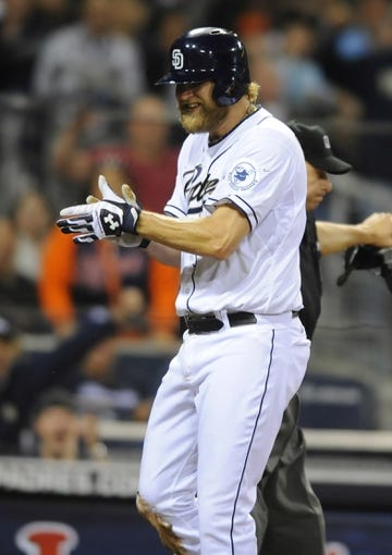 Apr 11, 2014; San Diego, CA, USA; San Diego Padres starting pitcher Andrew Cashner (34) celebrates after scoring during the seventh inning against the Detroit Tigers at Petco Park. Mandatory Credit: Christopher Hanewinckel-USA TODAY Sports