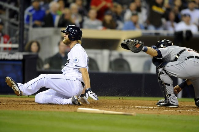 Apr 11, 2014; San Diego, CA, USA; San Diego Padres starting pitcher Andrew Cashner (34) scores ahead of a tag by Detroit Tigers catcher Alex Avila (13) during the seventh inning at Petco Park. Mandatory Credit: Christopher Hanewinckel-USA TODAY Sports