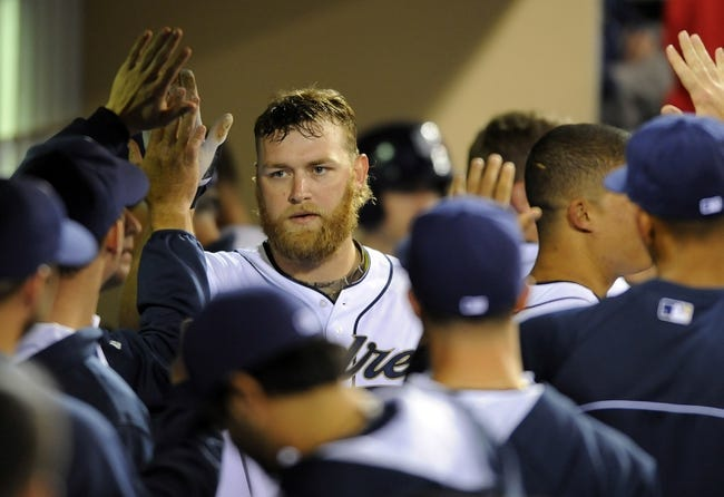 Apr 11, 2014; San Diego, CA, USA; San Diego Padres starting pitcher Andrew Cashner (34) is congratulated by teammates after scoring during the seventh inning against the Detroit Tigers at Petco Park. Mandatory Credit: Christopher Hanewinckel-USA TODAY Sports