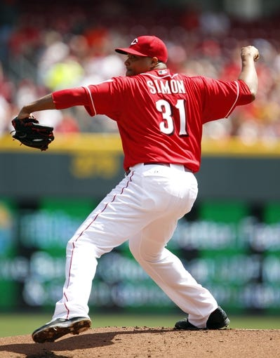Apr 12, 2014; Cincinnati, OH, USA; Cincinnati Reds starting pitcher Alfredo Simon (31) pitches during the first inning against the Tampa Bay Rays at Great American Ball Park. Mandatory Credit: Frank Victores-USA TODAY Sports