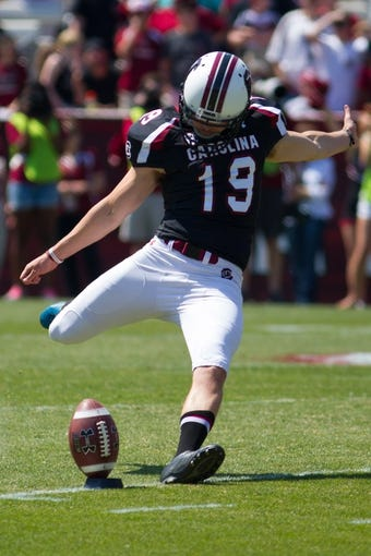 Apr 12, 2014; Columbia, SC, USA; South Carolina Gamecocks kicker Landon Ard (19) kicks the ball during the first half of the South Carolina spring game at Williams-Brice Stadium. Mandatory Credit: Joshua S. Kelly-USA TODAY Sports