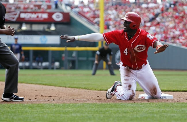 Apr 12, 2014; Cincinnati, OH, USA; Cincinnati Reds second baseman Brandon Phillips (4) argues being called out stealing third base during the fourth inning against the Tampa Bay Rays at Great American Ball Park. Mandatory Credit: Frank Victores-USA TODAY Sports