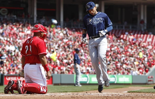 Apr 12, 2014; Cincinnati, OH, USA; Tampa Bay Rays first baseman James Loney (21) crosses home plate after hitting a home run during the second inning against the Cincinnati Reds at Great American Ball Park. Mandatory Credit: Frank Victores-USA TODAY Sports