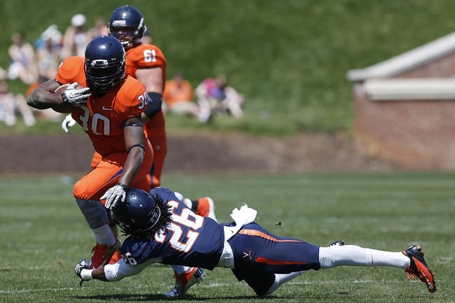 Apr 12, 2014; Charlottesville, VA, USA; Virginia Cavaliers running back LaChaston Smith (30) carries the ball as Cavaliers cornerback Maurice Canady (26) attempts the tackle during the Cavaliers Spring Game at Scott Stadium. Mandatory Credit: Geoff Burke-USA TODAY Sports