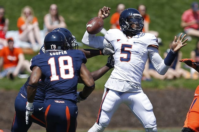 Apr 12, 2014; Charlottesville, VA, USA; Virginia Cavaliers quarterback David Watford (5) has the ball knocked away while attempting to pass by Cavaliers defensive end Max Valles (88) during the Cavaliers Spring Game at Scott Stadium. Mandatory Credit: Geoff Burke-USA TODAY Sports