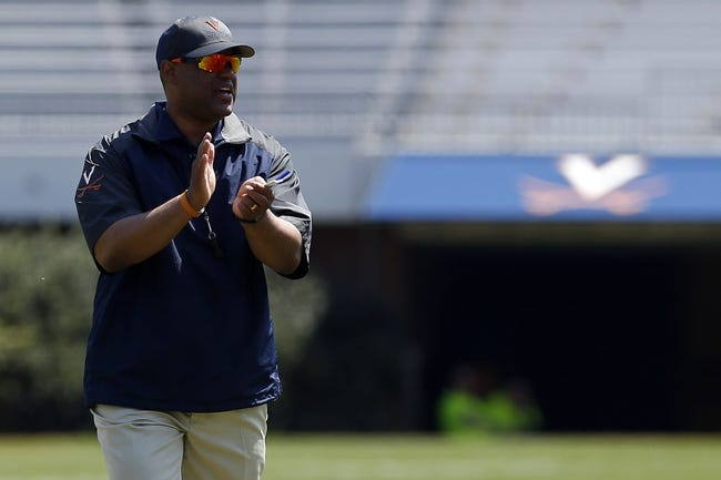 Apr 12, 2014; Charlottesville, VA, USA; Virginia Cavaliers head coach Mike London claps while on the field during the Cavaliers Spring Game at Scott Stadium. Mandatory Credit: Geoff Burke-USA TODAY Sports