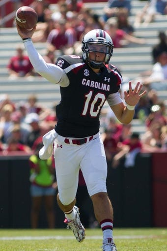 Apr 12, 2014; Columbia, SC, USA; South Carolina Gamecocks quarterback Perry Orth (10) passes the ball during the second half of the South Carolina spring game at Williams-Brice Stadium. Mandatory Credit: Joshua S. Kelly-USA TODAY Sports