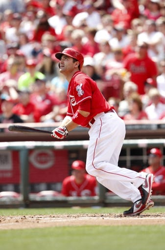 Apr 12, 2014; Cincinnati, OH, USA; Cincinnati Reds first baseman Joey Votto (19) doubles during the fourth inning against the Tampa Bay Rays at Great American Ball Park. Mandatory Credit: Frank Victores-USA TODAY Sports