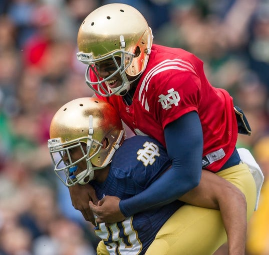 Apr 12, 2014; Notre Dame, IN, USA; Notre Dame Fighting Irish wide receiver C.J. Prosise (20) celebrates with quarterback Malik Zaire (8) after scoring a touchdown in the first quarter of the Blue-Gold game at Notre Dame Stadium. Mandatory Credit: Matt Cashore-USA TODAY Sports