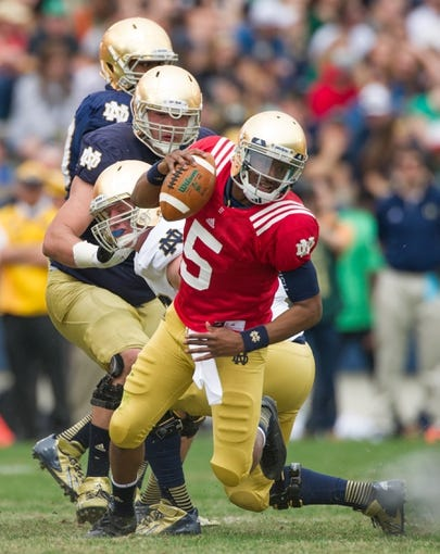 Apr 12, 2014; Notre Dame, IN, USA; Notre Dame Fighting Irish quarterback Everett Golson (5) runs with the ball in the third quarter of the Blue-Gold game at Notre Dame Stadium. Mandatory Credit: Matt Cashore-USA TODAY Sports