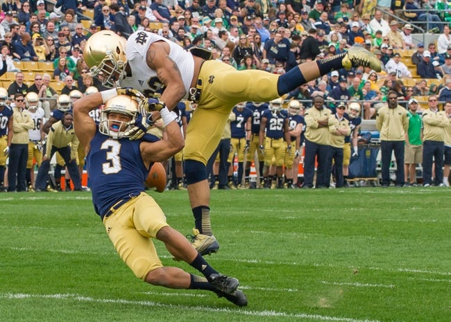 Apr 12, 2014; Notre Dame, IN, USA; Notre Dame Fighting Irish safety Elijah Shumate (22) breaks up a pass intended for wide receiver Amir Carlisle (3) in the first quarter of the Blue-Gold game at Notre Dame Stadium. Mandatory Credit: Matt Cashore-USA TODAY Sports