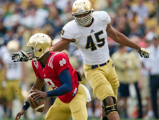 Apr 12, 2014; Notre Dame, IN, USA; Notre Dame Fighting Irish quarterback Malik Zaire (8) is pressured by linebacker Romeo Okwara (45) in the third quarter of the Blue-Gold Game at Notre Dame Stadium. The play counted as a sack. Mandatory Credit: Matt Cashore-USA TODAY Sports