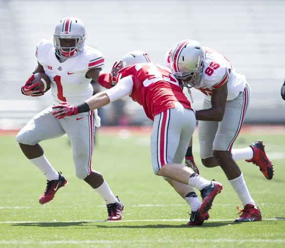 Apr 12, 2014; Columbus, OH, USA; Ohio State Gray Team wide receiver Johnnie Dixon (1) runs with the ball Ohio State Scarlet Team cornerback Nik Sarac (33) defends during the Ohio State Buckeyes Spring Game at Ohio Stadium. Mandatory Credit: Greg Bartram-USA TODAY Sports