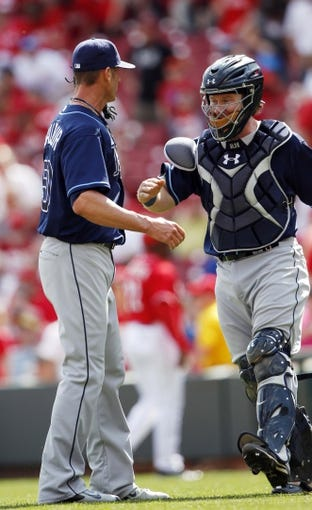 Apr 12, 2014; Cincinnati, OH, USA; Tampa Bay Rays catcher Ryan Hanigan (24) congratulates relief pitcher Grant Balfour (50) at the end of the game against the Cincinnati Reds at Great American Ball Park. Tampa defeated Cincinnati 1-0. Mandatory Credit: Frank Victores-USA TODAY Sports