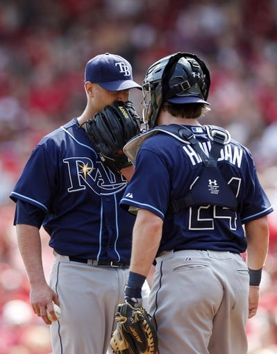 Apr 12, 2014; Cincinnati, OH, USA; Tampa Bay Rays catcher Ryan Hanigan (24) talks to starting pitcher Alex Cobb (53) during the seventh inning against the Cincinnati Reds at Great American Ball Park. Tampa defeated Cincinnati 1-0. Mandatory Credit: Frank Victores-USA TODAY Sports