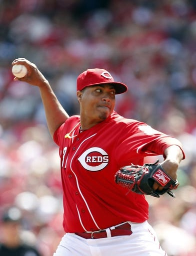 Apr 12, 2014; Cincinnati, OH, USA; Cincinnati Reds starting pitcher Alfredo Simon (31) pitches during the seventh inning against the Tampa Bay Rays at Great American Ball Park. Tampa defeated Cincinnati 1-0. Mandatory Credit: Frank Victores-USA TODAY Sports