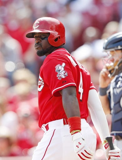 Apr 12, 2014; Cincinnati, OH, USA; Cincinnati Reds second baseman Brandon Phillips (4) bats during the ninth inning against the Tampa Bay Rays at Great American Ball Park. Tampa defeated Cincinnati 1-0. Mandatory Credit: Frank Victores-USA TODAY Sports