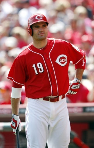 Apr 12, 2014; Cincinnati, OH, USA; Cincinnati Reds first baseman Joey Votto (19) in the on deck circle during the fourth inning against the Tampa Bay Rays at Great American Ball Park. Tampa defeated Cincinnati 1-0. Mandatory Credit: Frank Victores-USA TODAY Sports