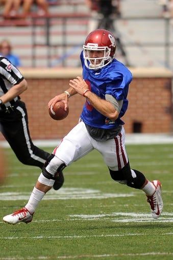 Apr 12, 2014; Norman, OK, USA; Oklahoma Sooners quarterback Trevor Knight (9) runs the ball during the spring game at Gaylord Family Oklahoma Memorial Stadium. Mandatory Credit: Mark D. Smith-USA TODAY Sports