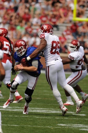 Apr 12, 2014; Norman, OK, USA; Oklahoma Sooners quarterback Trevor Knight (9) runs the ball before being contacted by Sooners defensive end Geneo Grissom (85) during the spring game at Gaylord Family Oklahoma Memorial Stadium. Mandatory Credit: Mark D. Smith-USA TODAY Sports