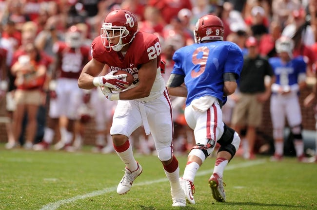 Apr 12, 2014; Norman, OK, USA; Oklahoma Sooners running back Alex Ross (28) runs the ball during the spring game at Gaylord Family Oklahoma Memorial Stadium. Mandatory Credit: Mark D. Smith-USA TODAY Sports