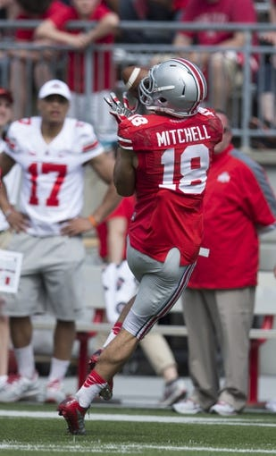 Apr 12, 2014; Columbus, OH, USA; Ohio State scarlet team wide receiver Kato Mitchell (18) catches a pass during the Ohio State Buckeyes spring game at Ohio Stadium. The scarlet team won the game 17-7. Mandatory Credit: Greg Bartram-USA TODAY Sports