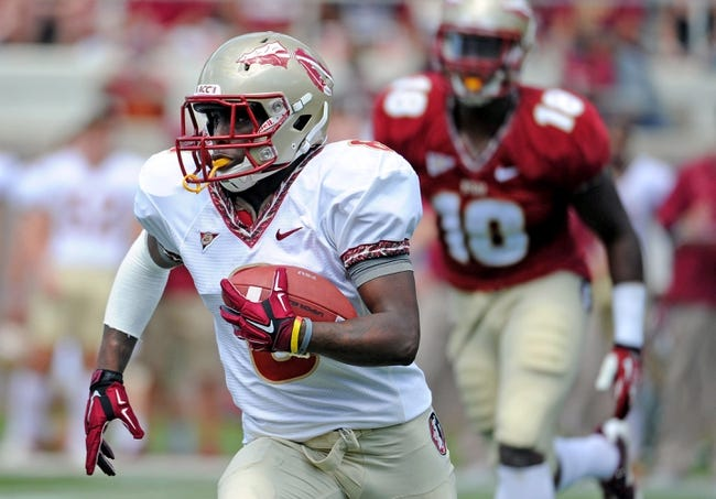 Apr 12, 2014; Tallahassee, FL, USA; Florida State Seminoles wide receiver Kermit Whitfield (8) runs the ball during the spring game at Doak Campbell Stadium. Mandatory Credit: Melina Vastola-USA TODAY Sports
