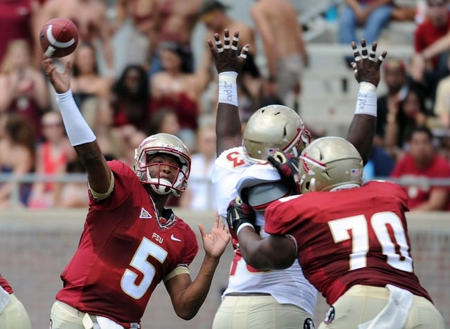 Apr 12, 2014; Tallahassee, FL, USA; Florida State Seminoles quarterback Jameis Winston (5) throws the ball during the spring game at Doak Campbell Stadium. Mandatory Credit: Melina Vastola-USA TODAY Sports