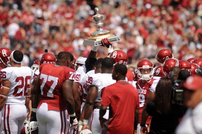 Apr 12, 2014; Norman, OK, USA; Oklahoma Sooner players hold up the Sugar Bowl trophy during the spring game at Gaylord Family Oklahoma Memorial Stadium. Mandatory Credit: Mark D. Smith-USA TODAY Sports