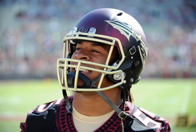 Apr 12, 2014; Tallahassee, FL, USA; Florida State Seminoles former running back Devonta Freeman (8) smiles as he models the new uniforms during the spring game at Doak Campbell Stadium. Mandatory Credit: Melina Vastola-USA TODAY Sports