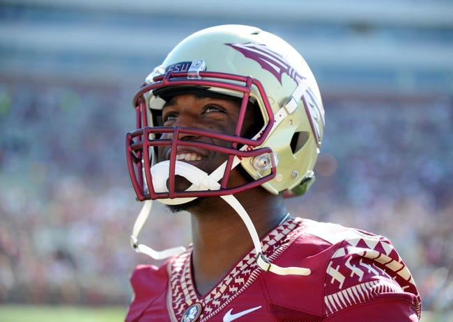 Apr 12, 2014; Tallahassee, FL, USA; Florida State Seminoles former linebacker Christian Jones (7) smiles as he models the new uniforms during the spring game at Doak Campbell Stadium. Mandatory Credit: Melina Vastola-USA TODAY Sports