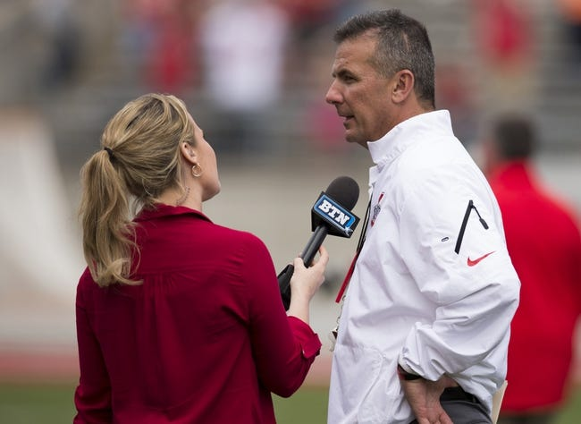 Apr 12, 2014; Columbus, OH, USA; Ohio State Buckeyes head coach Urban Meyer talks to the media after the Ohio State Buckeyes Spring Game at Ohio Stadium. The Scarlet team won 17-7. Mandatory Credit: Greg Bartram-USA TODAY Sports