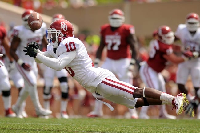 Apr 12, 2014; Norman, OK, USA; Oklahoma Sooners safety Quentin Hayes (10) dives for the ball during the spring game at Gaylord Family Oklahoma Memorial Stadium. Mandatory Credit: Mark D. Smith-USA TODAY Sports
